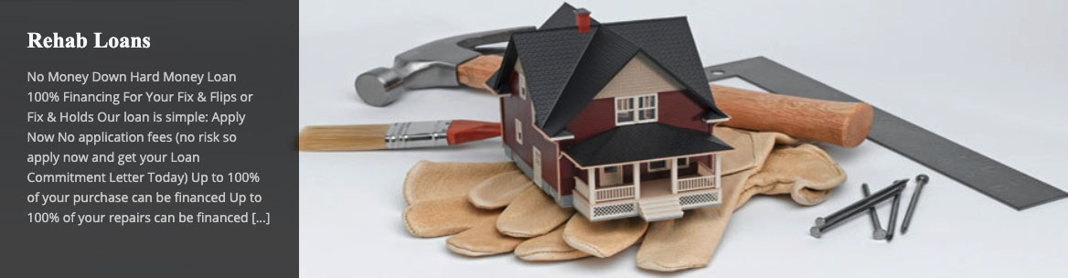 Image of a model house sitting on top of gloves and tools for remodeling